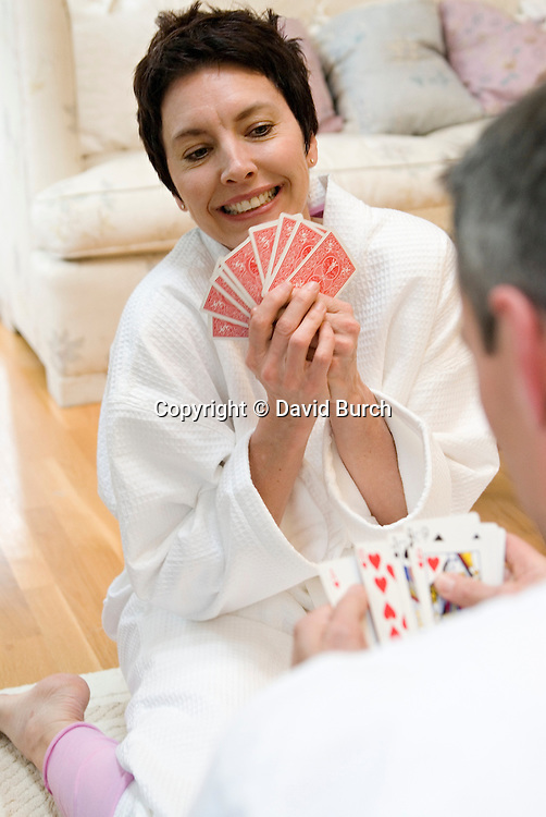 Mature woman playing cards with her mate