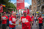 "© Joel Goodman - 07973 332324 . 23/08/2014 .  Manchester , UK . Stonewall parade goers with "" Some people are gay get over it "" placards in multiple languages . The parade through Manchester City Centre . Manchester Pride "" Big Weekend "" in Manchester "" today ( 23rd August 2014 ) . Photo credit : Joel Goodman"