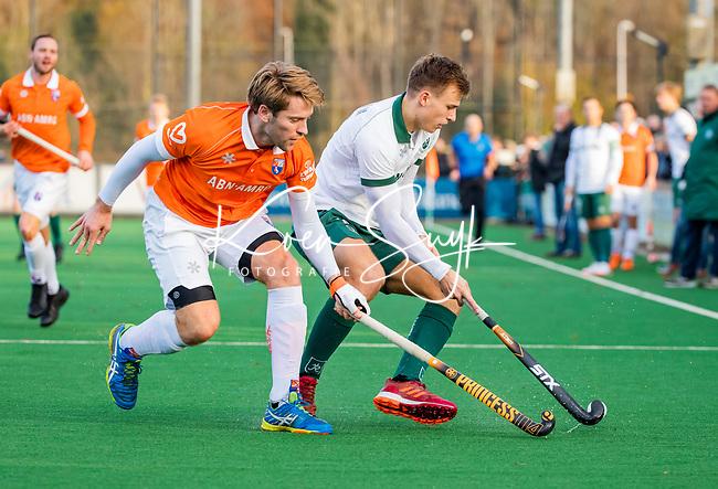 BLOEMENDAAL - Thijs van Dam (R'dam) met Mats de Groot (Bldaal) tijdens  hoofdklasse competitiewedstrijd  heren , Bloemendaal-Rotterdam (1-1) .COPYRIGHT KOEN SUYK