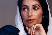 Karachi, Pakistan<br /> November 18, 1988<br /> <br /> Benazir Bhutto at home following the election that named her Pakistani Prime Minister.<br /> <br /> Benazir Bhutto is the eldest child of former Pakistan President and Prime Minister Zulfikar Ali Bhutto. She found herself placed under house arrest in the wake of her father's imprisonment and subsequent execution in 1979. In 1984 she became the leader in exile of the Pakistan Peoples Party (PPP), her father's party, though she was unable to make her political presence felt in Pakistan until after the death of General Muhammad Zia-ul-Haq. <br /> <br /> On 16 November 1988 Benazir's PPP won the largest bloc of seats in the National Assembly. Bhutto was sworn in as Prime Minister in December, at age 35 she became the first woman to head the government of a Muslim-majority state in modern times. <br /> <br /> She was removed from office 20 months later under orders of then-president Ghulam Ishaq Khan for alleged corruption. Bhutto was re-elected in 1993 but was again removed by President Farooq Leghari in 1996, on similar charges. Bhutto went into self-imposed exile in Dubai in 1998, until she returned to Pakistan on October 2007, after General Musharraf granted her amnesty and all corruption charges withdrawn.
