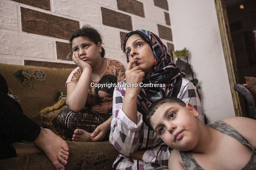 June 09, 2015 - Beirut, Lebanon: Hannan (centre), and two of her children (Muhammed Ali/right and daughter/no name/left), a Palestinian refugee family is seen inside their house in Shatila refugee camp. (Photo/Narciso Contreras)