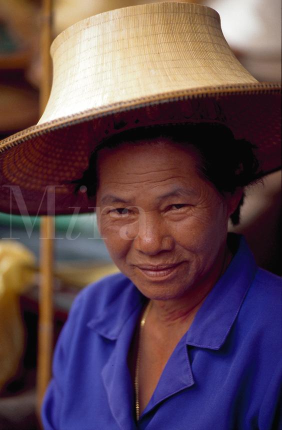 Thai woman in a straw hat.