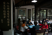 Meishan, Sichuan province, China, October 2014 - Visitors play mahjong at the Su Dongpo Memorial Tea House. Su was a famous poet and politician of Song dynasty and native of Meishan.