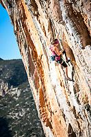 Eliza Sprecher climbing Bert 7b+ at the Elona wall, Leonido, Greece