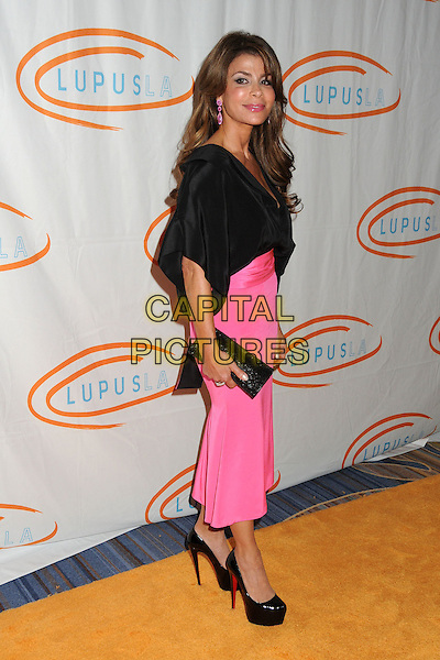 Paula Abdul.12th Annual Lupus LA Orange Ball held at the Beverly Wilshire Hotel, Beverly Hills, California, USA..May 24th, 2012.full length blouse top pink skirt clutch bag black side .CAP/ADM/BP.©Byron Purvis/AdMedia/Capital Pictures.