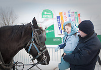 Caterina Miserandino pets a horse as her father Dominick looks on at the Quebec Winter Carnival (Carnaval de Quebec) in Quebec city, February 3, 2010. With close to one million participants, it has grown to become the third largest winter celebration in the world.