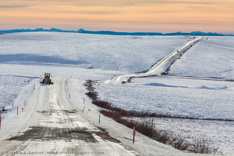 Grader plows the James Dalton Highway, the Haul road, in winter conditions.