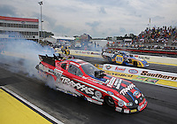 May 10, 2013; Commerce, GA, USA: NHRA funny car driver Courtney Force (near lane) burns out alongside Ron Capps during qualifying for the Southern Nationals at Atlanta Dragway. Mandatory Credit: Mark J. Rebilas-