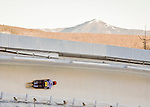 8 January 2016: Sophia Griebel, competing for Germany, slides through Curve 14, with Whiteface Mountain as a backdrop, on her first run of the BMW IBSF World Cup Skeleton race at the Olympic Sports Track in Lake Placid, New York, USA. Mandatory Credit: Ed Wolfstein Photo *** RAW (NEF) Image File Available ***
