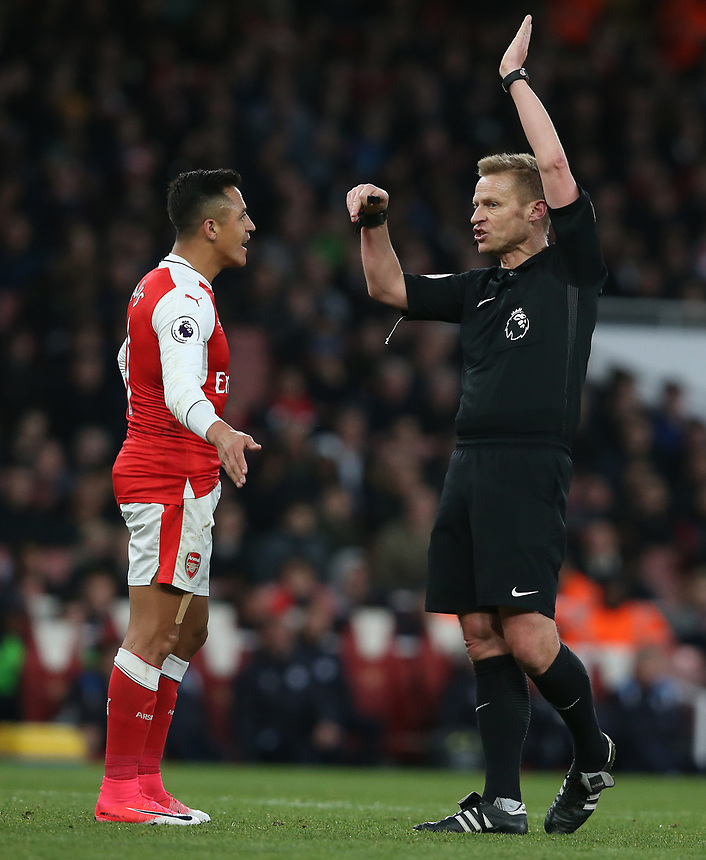 Referee Mike Jones and Arsenal's Alexis Sanchez<br /> <br /> Photographer Stephen White/CameraSport<br /> <br /> The Premier League - Arsenal v Leicester City - Wednesday 26th April 2017 - Emirates Stadium - London<br /> <br /> World Copyright &copy; 2017 CameraSport. All rights reserved. 43 Linden Ave. Countesthorpe. Leicester. England. LE8 5PG - Tel: +44 (0) 116 277 4147 - admin@camerasport.com - www.camerasport.com