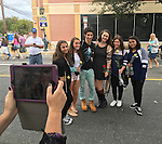 Merrick, New York, USA. 27th September 2015. ROBBIE ROSEN, an American Idol Season 10 Semi-finalist in 2011, poses with fans for a photo captured with a smart tablet, L-R, BRITTANY WALLACH, EMILY HALLERAN, KATE DERWIN, JACQUI BERKOWIZ, and ANJALI PURI at the Merrick Chamber of Commerce Fall Festival on Long Island. Rosen and the teen girls are all Merrick residents.