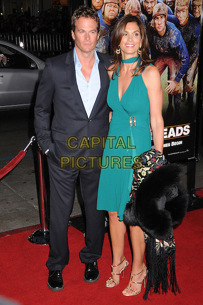"RANDE GERBER & CINDY CRAWFORD.""Leatherheads"" Los Angeles Premiere at Grauman's Chinese Theatre, Hollywood, California, USA..March 31st, 2008.full length black suit green dress married husband wife randy hand in pocket strappy sandals .CAP/ADM/BP.©Byron Purvis/AdMedia/Capital Pictures."