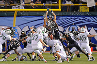 20 December 2011:  FIU's special teams unit (pictured, defensive end Tourek Williams (97), linebacker Kenneth Dillard (41), defensive back Justin Halley (32)) attempt to block a field goal attempt by Marshall kicker Tyler Warner (37) in the fourth quarter as the Marshall University Thundering Herd defeated the FIU Golden Panthers, 20-10, to win the Beef 'O'Brady's St. Petersburg Bowl at Tropicana Field in St. Petersburg, Florida.