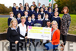 Fourth class at Caherleaheen National School present the sum of €540 to the Kerry Hospice at the school on Thursday.  Front L-r, Nuala Finnegan (Kerry Hospice), Maura Sullivan (Kerry Hospice), Damien Finn (Teacher), Brid Murphy (Co-ordinated the coffee afternoon) and Mary Connelly (Principal).