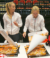 The Netherlands, Den Bosch, 16.04.2014. Fed Cup Netherlands-Japan, Team Netherlands, Arantxa Rus and Kiki Bertens signing autographs on posters<br /> Photo:Tennisimages/Henk Koster
