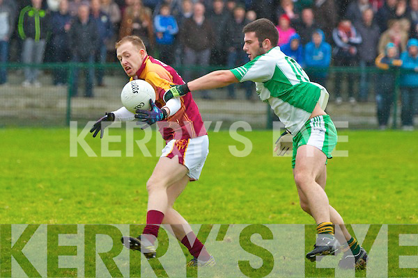The Bernard O'Callaghan Memorial Senior Football Championship 2013, Round 1 Ballyduff (white/green) V Duagh (Red) which took place on Sunday in Frank Sheehy Park, Listowel.  Referee: Billy McElligot, Listowel Emmets.<br /> <br /> Daniel O'Donoghue of Duagh being put under pressure by Pat Joe Connolly of Ballyduff in his own half.