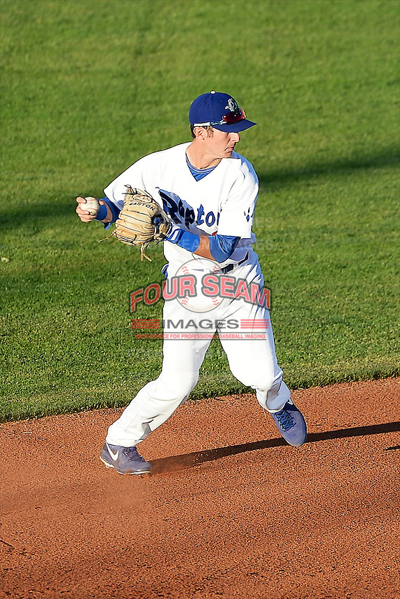 Brandon Trinkwon #9 of the Ogden Raptors plays on defense and fires to first base against the Idaho Falls Chukars at Lindquist Field on June 22, 2013 in Ogden, Utah.  (Stephen Smith/Four Seam Images)