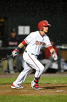 Harrisburg Senators first baseman Matt Skole (10) at bat in the rain during a game against the New Britain Rock Cats on April 28, 2014 at Metro Bank Park in Harrisburg, Pennsylvania.  Harrisburg defeated New Britain 9-0.  (Mike Janes/Four Seam Images)