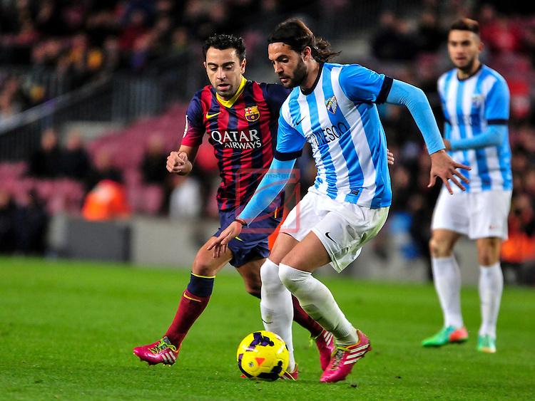 League BBVA 2013/2014 - Game: 21.<br /> FC Barcelona vs Malaga CF: 3-0.<br /> Xavi Hernandez vs Sergio Sanchez