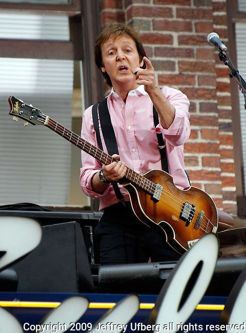 July 15, 2009 New York: Singer / Musician Paul McCartney performs atop the marquee at the Ed Sullivan Theatre on July 15, 2009 in New York.