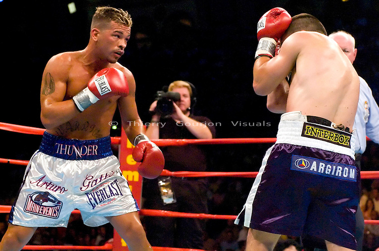 Arturo Gatti (l) connects against his opponent Leonard Dorin  during the WBC Super Lightweight Championship at the Boardwalk Hall in Atlantic City, New Jersey on July 24, 2004. Gatti won the fight by KO in the 2nd Round with a left body shot to the body. Photo by Thierry Gourjon.