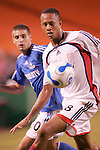 Aug 19 2007:  Khano Smith (front) of the Revolution shields the ball from Carlos Marinelli (10) of the Wizards.  The MLS Kansas City Wizards were defeated by the visiting New England Revolution 0-1 at Arrowhead Stadium in Kansas City, Missouri, in a regular season league soccer match.
