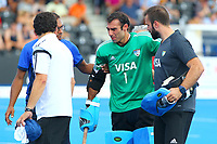 Argentine goalkeeper Juan Vivaldi is helped off the pitch due to injury during the Hockey World League Semi-Final match between England and Argentina at the Olympic Park, London, England on 18 June 2017. Photo by Steve McCarthy.