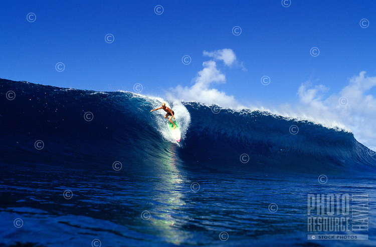 Man surfing the legendary waves off the North Shore of Oahu