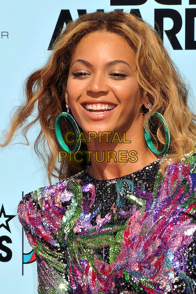 BEYONCE KNOWLES .2009 BET Awards - Arrivals held at the Shrine Auditorium, Los Angeles, CA, USA..June 28th, 2009.headshot portrait pink purple green black sequins sequined hoop earrings large giant oversized .CAP/ADM/BP.©Byron Purvis/AdMedia/Capital Pictures.