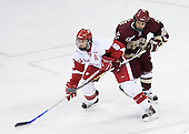 Dan Bertram 22 of Boston College works to tie up Jeff Likens 5 of the University of Wisconsin. The Boston College Eagles defeated the University of Wisconsin Badgers 3-0 on Friday, October 27, 2006, at the Kohl Center in Madison, Wisconsin in their first meeting since the 2006 Frozen Four Final which Wisconsin won 2-1 to take the national championship.<br />