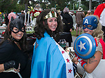 Batgirl Shannon Hambright, Wonder Woman Stephanie Ellis and Captain America Samantha Bartlett during Pops on the River at Wingfield Park in Reno, Nevada on Saturday, July 14, 2018.