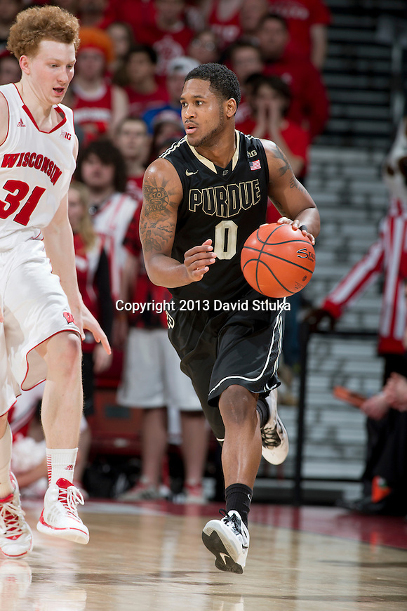Purdue Boilermakers guard Terone Johnson (0) handles the ball during a Big Ten Conference NCAA college basketball game against the Wisconsin Badgers Sunday, March 3, 2013, in Madison, Wis. Purdue won 69-56. (Photo by David Stluka)