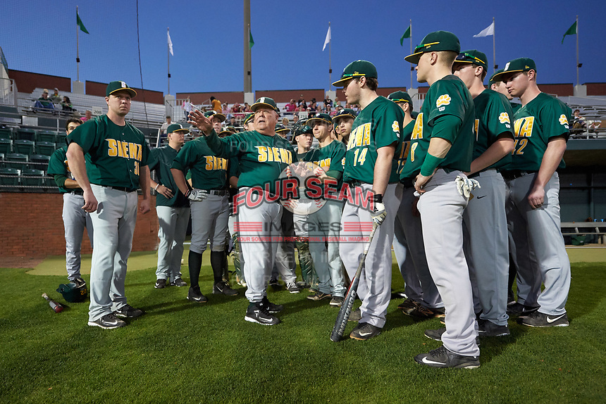 Siena Saints head coach Tony Rossi (40) goes over the ground rules with his team before a game against the Stetson Hatters on February 23, 2016 at Melching Field at Conrad Park in DeLand, Florida.  Stetson defeated Siena 5-3.  (Mike Janes/Four Seam Images)