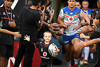 Young fan leads the Warriors onto the field.<br /> NRL Premiership Rugby League. Vodafone Warriors v Brisbane Broncos. Mt Smart Stadium. 14th April 2018. Copyright Photo: Jeremy Ward / www.photosport.nz /SWpix.com