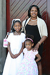Tshego Sonti with her mum Rachela and sister Kabela at the Fatima Communion in St. Marys Church...Photo NEWSFILE/Jenny Matthews.(Photo credit should read Jenny Matthews/NEWSFILE)....This Picture has been sent you under the condtions enclosed by:.Newsfile Ltd..The Studio,.Millmount Abbey,.Drogheda,.Co Meath..Ireland..Tel: +353(0)41-9871240.Fax: +353(0)41-9871260.GSM: +353(0)86-2500958.email: pictures@newsfile.ie.www.newsfile.ie.FTP: 193.120.102.198.