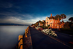 A photo of the famous Battery Row mansions in the historic city of Charleston SC. I took this photo of the Charleston Battery at sunrise. This photo of the Charleston Battery shows the Battery mansions starting to get the first morning  light. Take a look at the other photos in this Charleston photo gallery to see why I love visiting Charleston.  Very few places are as beautiful as Charleston, SC. The historic antebellum mansions line Charlestons historic Battery. The historic Charleston Battery and the Charleston SC Area are one of my favorite subjects to photograph.