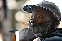 Raymond Sawyer smokes while sitting on his regular bench in downtown Santa Rosa on November 30, 2013. Sawyer, 68, says he has been living on Santa Rosa's streets for seven years and that crowded shelters stress him out. He often moves from bench to bench to get some space. (Alvin Jornada / The Press Democrat)