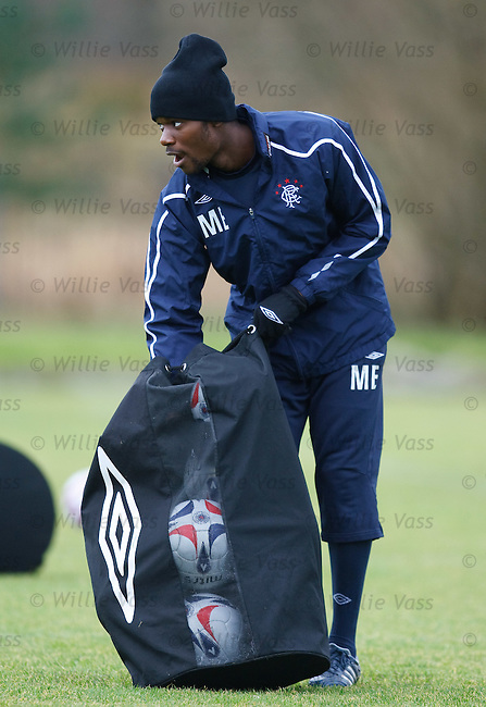 Maurice Edu pinches some training balls