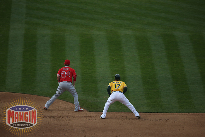 OAKLAND, CA - APRIL 6:  Yonder Alonso #17 of the Oakland Athletics is held close to first base by Los Angeles Angels of Anaheim first baseman C.J. Cron #24 during the game at the Oakland Coliseum on Thursday, April 6, 2017 in Oakland, California. (Photo by Brad Mangin)