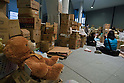 Saitama, Japan - A photo made available on March, 22, 2011 shows a stuffed teddy bear fixed on top of a box where outside donations from the public are being received at Saitama Super Arena, a temporary shelter in Saitama, north of Tokyo. Thousands of residents from Fukushima evacuated their town as high levels of radiation continued to be a high risk from the quake-hit nuclear plant. (Photo by Christopher Jue/Nippon News/AFLO)
