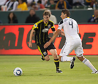 Columbus Crew midfielder Brian Carroll (16) moves past Galaxy defender Omar Gonzalez (4) during the first half of the game between LA Galaxy and the Columbus Crew at the Home Depot Center in Carson, CA, on September 11, 2010. LA Galaxy 3, Columbus Crew 1