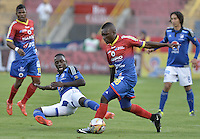 PASTO -COLOMBIA, 12-07-2015: Francisco Cordoba (Der) jugador del Deportivo Pasto disputa el balón con Deiver Machado (Izq) jugador de Millonarios durante partido por la primera fecha de la Liga Águila II 2015 jugado en el estadio La Libertad de la ciudad de Pasto./ Francisco Cordoba (R) player of Deportivo Pasto vies for the ball with Deiver Machado (L) player of Millonarios during the match for the first date of the Aguila League II 2015 played at La Libertad stadium in Pasto city. Photo: VizzorImage / Gabriel Aponte / Staff