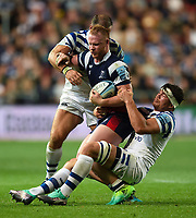 Will Hurrell of Bristol Bears is double-tackled by Francois Louw and Jamie Roberts of Bath Rugby. Gallagher Premiership match, between Bristol Bears and Bath Rugby on August 31, 2018 at Ashton Gate Stadium in Bristol, England. Photo by: Patrick Khachfe / Onside Images