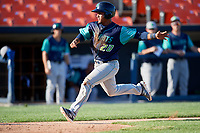 Lynchburg Hillcats catcher Angel Lopez Alvarez (20) slides home safely during the first game of a doubleheader against the Frederick Keys on June 12, 2018 at Nymeo Field at Harry Grove Stadium in Frederick, Maryland.  Frederick defeated Lynchburg 2-1.  (Mike Janes/Four Seam Images)