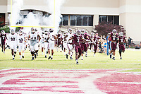 Teams entering the field for Maroon and White Spring game during Super Bulldog Weekend.<br />  (photo by Beth Wynn / &copy; Mississippi State University)