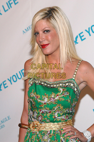 "TORI SPELLING.American Eagle Outfitters' ""Live Your Life Contest"" winners at the Union Square flagship store in Manhattan, New York, New York..July 27th, 2005  .Photo Credit: Patti Ouderkirk/AdMedia.half length green pattern print dress gold belt hand  wooden bracelet white watch.www.capitalpictures.com.sales@capitalpictures.com.© Capital Pictures."