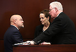 Nevada Assemblyman Ira Hansen, R-Sparks, left, talks with Assembly Speaker John Hambrick, R-Las Vegas, and Chief Clerk Susan Furlong at the Legislative Building in Carson City, Nev., on Monday, Feb. 9, 2015. <br /> Photo by Cathleen Allison