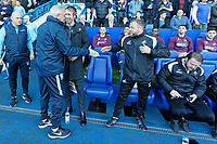 (L-R) Sheffield Wednesday manager Steve Bruce greets manager Graham Potter and Billy Reid, assistant manager for Swansea during the Sky Bet Championship match between Sheffield Wednesday and Swansea City at Hillsborough Stadium, Sheffield, England, UK. Saturday 23 February 2019