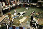 Emergency crew pump water from the flooded main floor lobby of the Seapearl Resort located at the popular tourist destination of Patong Beach on Phuket Island, Thailand two days after the tsunami ravaged the West Coast of Thailand. On December 26, 2004, a major earthquake generated tsunamis that ravaged coastlines from Southeast Asia to Africa. Approximately 275,000 people were killed and tens of thousands were left homeless, making it one of the deadliest natural disasters in modern history.