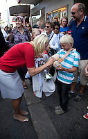 Crown Prince Haakon and Crown Princess Mette-Marit of Norway visit  Arendal  during a  three day visit, to the county of Aust-Agder in Southern Norway..Draws a flower on a young boys plaster cast